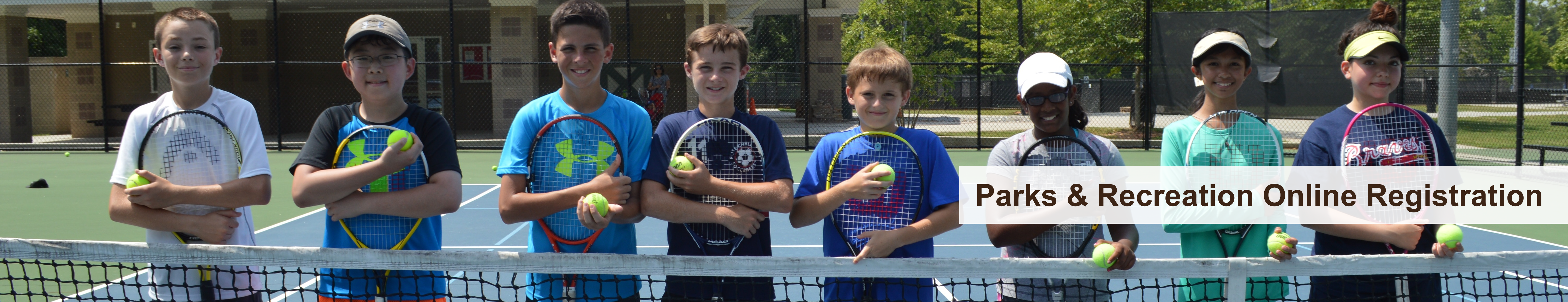 Young participants in Tennis Program and Text reading Parks and Recreation Online Registration
